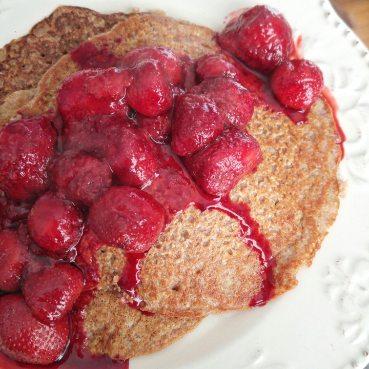 Homemade Oat Pancakes Topped with Hot Strawberries